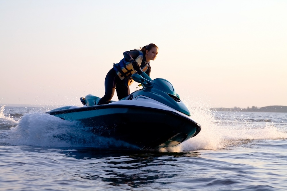 Photo of a woman on a jetski in the water --powersports insurance in Detroit STATE | Mason-McBride