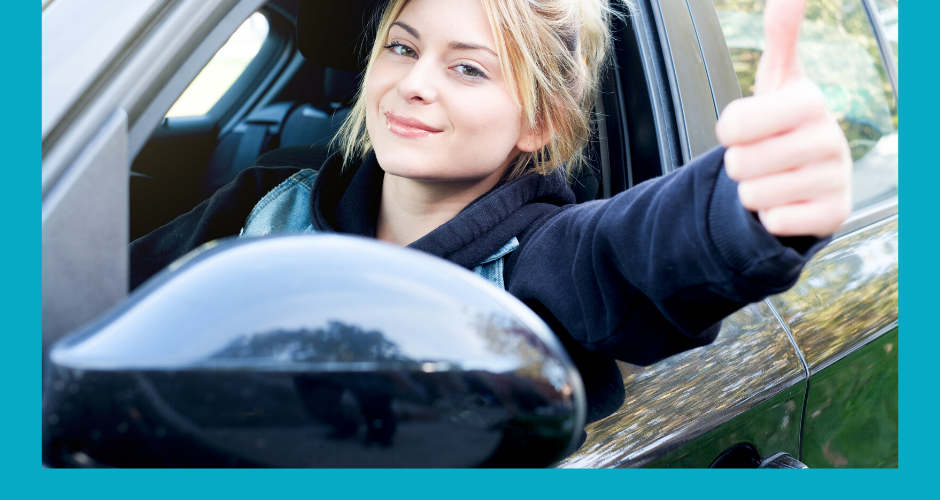 Photo of young woman driving car giving the thumbs up sign