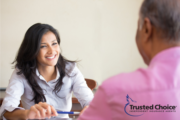 Photo of business meeting with woman and man. Trusted Choice Independent Insurance Agents logo.