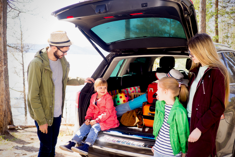 Photo of a family on a road trip. Top Ten Driving Safety Tips.
