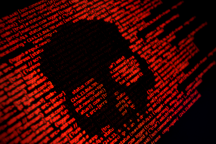 Five recent developments in ransomware and what to expect next - code on screen in shape of a skull