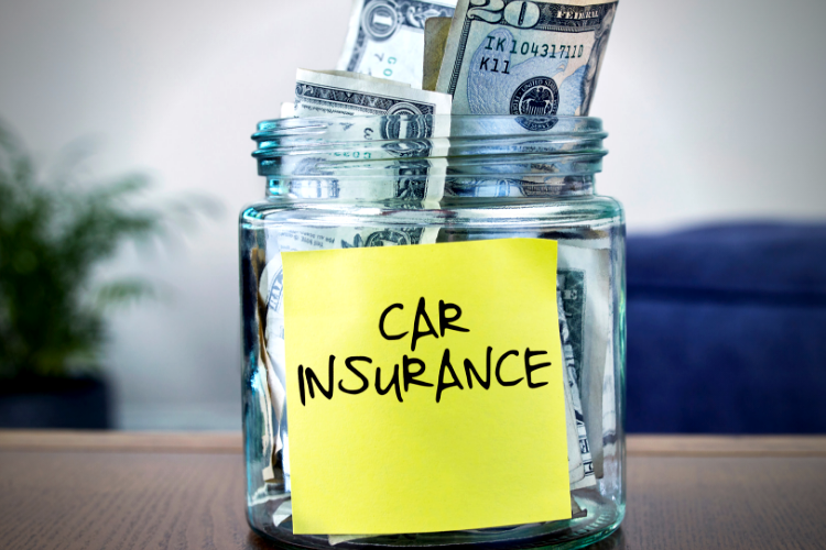 """Photo of cash bills in a jar with a label that reads :auto insurance"""""""